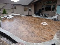 Beautifully stamped concrete entryway and driveway blend perfectly ...