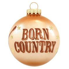 """Exclusively crafted for Bronner's from glass in Hungary, our two-tone brown and beige ball ornament is decorated with the words """"BORN COUNTRY"""" in a large, bold, western-style font framed by arching, g Christmas Store, Handmade Christmas, Christmas Lights, Christmas Crafts, Christmas Decorations, Christmas Ornaments, Holiday Decor, Christmas Ideas, Western Theme"""