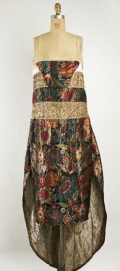 Evening dress Design House: Callot Soeurs (French, active 1895–1937) Date: fall/winter 1920–21 Culture: French Medium: silk, metallic thread Dimensions: Length: 48 in. (121.9 cm) Credit Line: Gift of David Toser, 1977