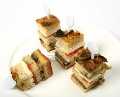 A club sandwich cut into small pieces as a canape.