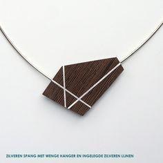 Pendant by Inge Rens. Wenge wood, silver.