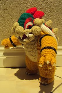This particular Bowser is modeled off of the more recent version of Bowser (Super Mario Bros. Mario Crochet, Easy Crochet, Crochet Toys, Free Crochet, Knit Crochet, Crochet Things, Mario Crafts, Knitting Patterns, Crochet Patterns
