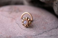 NOSE Ring STUD 14k yellow gold filled with Mother of Pearl Handcrafted Also Cartilage or ear stud. $19.95, via Etsy.