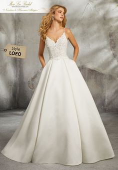 Mori Lee Bridal 8272 wedding dress available at The Castle. We are an authorized… Mori Lee Bridal 8272 wedding dress available at The Castle. We are an authorized retailer for all Mori Lee Bridal dresses and every 8272 is brand new with all original tags! Boho Wedding Dress With Sleeves, Classic Wedding Dress, Bridal Wedding Dresses, Wedding Dress Styles, Dream Wedding Dresses, Bridesmaid Dresses, Lace Wedding, Satin Gown, Mori Lee Wedding Dress