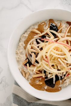 Almond Butter & Jelly Oatmeal Bowl with Spiralized Apples and Toasted Almonds