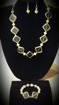 Tint of yellow glass beads with yellow glass spacers necklace, bracelet and earrings. Special order