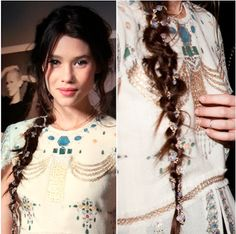 French Actress Astrid Berges-Frisbey; gold string and crystal orbs weaved through braid