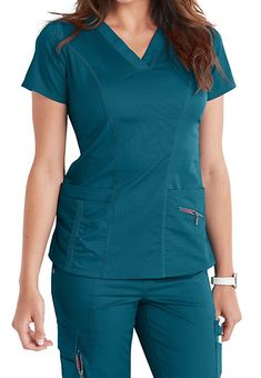 The Beyond Scrubs Ellie v-neck scrub top includes four pockets and plush stretch fabric. Shop for yours at Scrubs & Beyond. Yoga Scrub Pants, Beautiful Nurse, Scrubs Outfit, Medical Scrubs, Blue V, Costume, Scrub Tops, V Neck Tops, Stretch Fabric