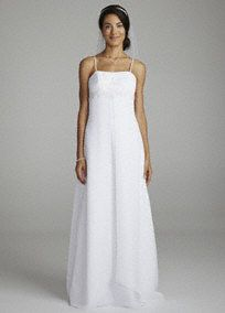 This gown is the perfect combination of modern chic and classic allure!  Spaghetti strap bodice features ultra feminine beaded floral appliques.  Empire waist helps create a flattering silhouette.  Long chiffon skirt with split-front detail adds dimension and a flowy look.  Fully lined. Back zip. Imported polyester. Dry clean. Also available in plus sizes as Style 9OP8077
