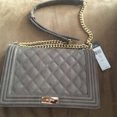 BCBG taupe quilted bag Faux leather, quilted. Size L. Brand new with tags. Taupe color with gold tone hardware with dustbag. BCBG Bags Shoulder Bags