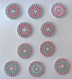 Pretty little quilling designs - see her other designs for earrings, etc. at her Etsy site!