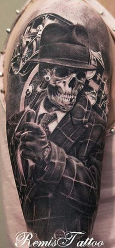 Cool looking tattoo of a skeletal gunman.  A unique yet interesting tattoo piece that will surely grab anyone's attention.