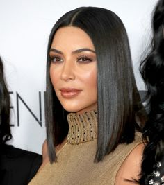 Kim Kardashian's Neutral tan Makeup + sleek bob Haircut are on-point.
