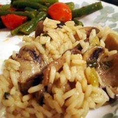 Mushroom Rice...GREAT side dish!!... 2 teaspoons butter  6 mushrooms, coarsely chopped  1 clove garlic, minced  1 green onion, finely chopped  2 cups chicken broth  1 cup uncooked white rice  1/2 teaspoon chopped fresh parsley  salt and pepper to taste...