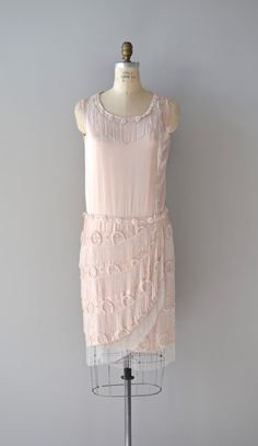 French 75 dress / vintage 1920s petal pink silk dress with milky white beaded fringe collar, milky white linear and geometric heavily beaded skirt. Classic shift shape with dropped waist, fold over skirt with beaded fringe ad side closures.