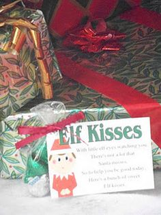 Elf Kisses printable bag topper...leave your kids some hershey kisses from the Elf.