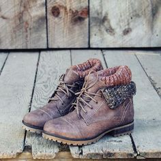 Chilly nor'wester winds won't bother you this fall in these darling cozy boots. A soft brown base pairs with a flap-over top design and sweet boot sock detail. Lace-up front with a rugged treaded sole
