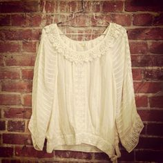 Leifsdottier cream colored top with tie at the bottom $20/Size 8