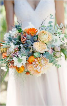 Bridal bouquet, cafe au lait dahlias, orange ranunculus, blue thistle, summer wedding flowers // Pictilio