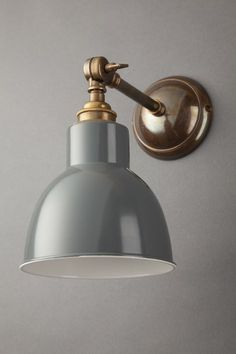 The Churchill is an industrial wall light featuring a large shade. The three different finishes available for the metalwork make the Churchill capable of evoking either a classic or more modern look. The options are either a polished nickel, antique brass Industrial Wall Lights, Industrial Light Fixtures, Kitchen Lighting Fixtures, Sconce Lighting, Light Fittings, Bookcase Lighting, Brass Wall Lights, Modern Wall Lights, Living Room Lighting