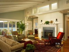 cognac color Traditional Living Room Decorating ideas Providence accent doorframe beadboard beams California ranch Fireplace french windows green green wall paint leather armchair oriental carpet plant red chair skylight sloping ceiling sofa
