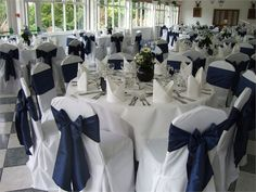 White chair covers with midnight blue taffeta sashes