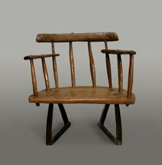 Welsh oak stick-back chair from Cardiganshire, circa 1800.  The top rail is supported on four well-worn turnings with two armrests either side. All is supported by four shaped legs with unusual separate stretchers.