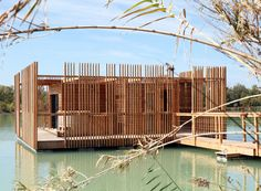 atelier LAVIT's prefabricated hotel suites float on a lake in the south of france