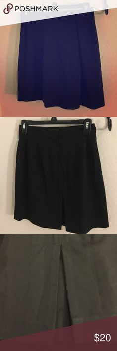 Pippa Black Work Skirt Perfect for work. Two pleats at the front and a slit in the back. Zipper and latch closure. The slit in the back has another piece of black fabric behind it so there's movement without showing too much skin. Pippa Skirts Midi