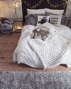 magical cozy bedroom -- love the white bedding and white chunky knit throw
