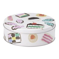 """Life is better with a little something sweet. Kate spade new york's One Smart Cookie Tin comes with three tin cookies cutters in fun shapes that are perfect for any occasion. The beautiful tin boasts a whimsical pattern of colourful treats, making it a lovely gift (with or without cookies). Cookie cutter height: 3/4"""" each. Tin: 7.5"""" diameter. Tin. Hand-wash."""