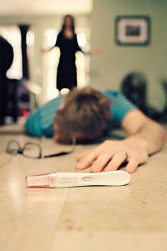 Creative Ways To Annouce Pregnancy - Test and Dad On The Floor