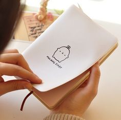 Molang journal--protective cover, flexible binding, tuck-in pen holder, calendar, space for notes, undated.