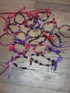 "Red&Purple Bracelets I made for a craft show...""Red Hat Ladies"""