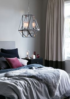 The Beacon Lighting Vaille 3 light pendant in chrome with chrome lampholders.