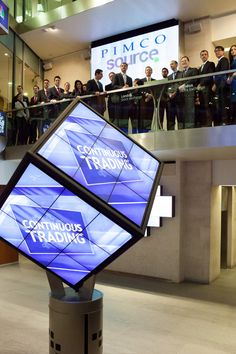 Digital signage in the form of a rotating digital cube situated in the entrance of the London Stock Exchange. It is used as part of the market openings. The Cube was designed, manufactured and installed by 10 Squared. Retail Technology, London Stock Exchange, Tower Design, Digital Signage, Business Signs, Kiosk, Creative Business, Entrance, Cube