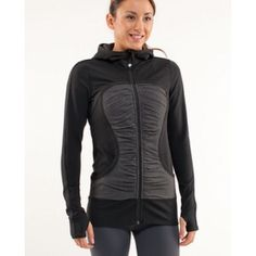 Lululemon athletica Pure Balance jacket 4 Perfect condition pure balance jacket. Black and charcoal colored. Size 4/ ex-small. Fits tight in the arms, made of Luon- a nylon and Lycra blend that is sweat wicking and breathable. I purchased this to match a pair of crops and ended up never wearing it. It is on the longer side and hits at the top of the hips. This jacket is beautiful but I never wear it lululemon athletica Jackets & Coats