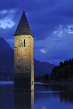Church tower at night in Lago di Resia at Curon Venosta / Graun, Dolomites, Italy