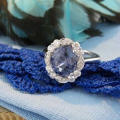 Blue spinel with diamonds in 18K white gold.  Spinel is an August birthstone. www.zomacolor.com