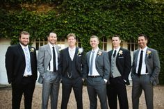 groomsmen in mismatched gray and black...if i can talk Levi into this - maybe they have to have boutonnieres