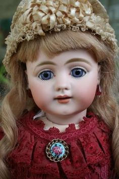 Offered out o f my collection is this 22.5 Simon Halbig 719 German bisque Child doll. She has a perfect bisque socket head without damage or
