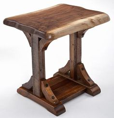 Black walnut and barnwood join to create a classic western style corbel end table.  The edge of this black walnut is left natural then gentle sanded to preserve its natural rounded character.  American black walnut is the king of woods in the northern hemisphere.  Loved for its deep chocolate tones and ease of workability walnut
