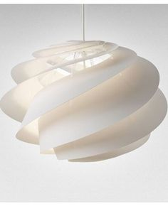 These hand-folded sculptural pendant shades were designed by architectØivind Slaatto.With its spiral panels and transparent diffuser, Swirl was designed to prevent unpleasant glare from its light source.