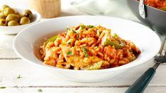 Spanish rice recipe that brings home the tastes of the Mediterranean. Easy to prepare, this dish is perfect for weeknight family meals.