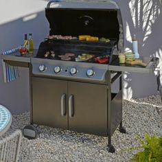 This great gas BBQ comes with all the trimmings! It includes a warming rack and foldable side shelves. #Summer #Barbecue