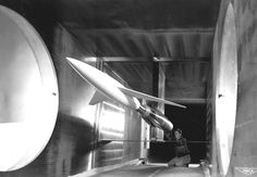 Testing advanced designs for high-speed aircraft, an engineer makes final calibrations to a model mounted in the 6 x 6 Foot Supersonic Wind Tunnel at the NACA Ames Aeronautical Laboratory, Moffett Field, California.
