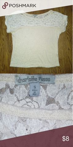 Charlotte Russe lace top Small +Great used condition +Worn a handful of times +Has lace design on sleeves, upper front,  and upper back +Short sleeve, rolled cuffs +Brand: Charlotte Russe +Size: Small +NO trades; Offers always welcome Charlotte Russe Tops