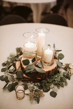 easy homemade rustic wedding centerpieces with candle lights Simple Wedding Centerpieces, Rustic Centerpiece Wedding, Centerpiece Flowers, Eucalyptus Centerpiece, Rustic Table Centerpieces, Rustic Wedding Decorations, Winter Wedding Centerpieces, Christmas Wedding Decorations, Wedding Reception Table Decorations