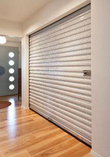 Janus roll up door used as bedroom closet door.