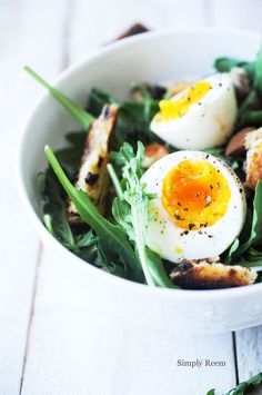 egg over arugula